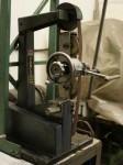 Jig designed by Baker Engineering to fine grind suction port